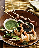 Grilled shrimp and beef kebabs with dips
