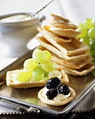 Tart cases filled with soft cheese, blackberries & grapes