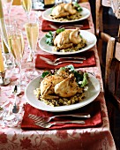 Festive table with stuffed chickens and sparkling wine