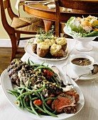 Roast beef, mushroom sauce, baked potatoes and salad