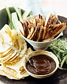 Peking duck with traditional accompaniments (China)