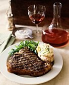 Grilled Porterhouse steak with baked potato & salad
