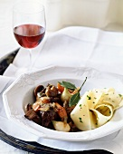 Lamb ragout with pappardelle and glass of red wine