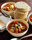 Tomato and potato soup and a pile of crackers