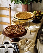 Pecan pie, pumpkin pie and coffee on buffet table