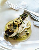 Poached swordfish with lemon and herbs in olive oil