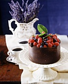 Berry cake with chocolate case, coffee