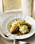 Chicken with dumplings, leeks, carrots and peas