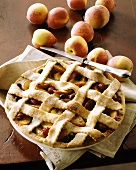 Peach and berry pie with pastry lattice