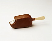 Chocolate-coated ice cream on stick