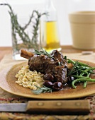 Lamb shank with rice-shaped pasta and green beans