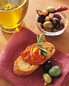 Crostini with pepper cream and pickled olives