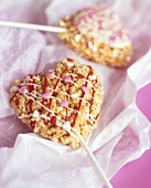 Caramelised puffed rice hearts on sticks