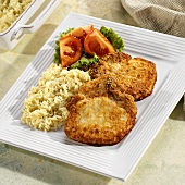 Pork chops with mustard and Parmesan coating and rice