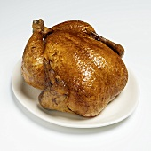 Whole Roast Turkey on a White Platter on White Background