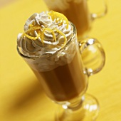 Coffee drink with cream topping and lemon zest