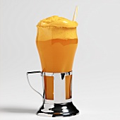 A glass of Orange Fizz