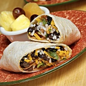 Burrito filled with cheese, black beans and rice
