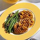 Pork chops with dried fruit, green beans and mushrooms