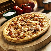 Chicken, Bacon, Tomato and Fontina Cheese Pizza on Wooden Cutting Board