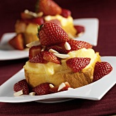 Individual Servings of Rum Cake with Vanilla Pudding, Strawberries and Almonds, Close Up