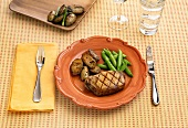 Place Setting with Grilled Boneless Pork Chop with Potatoes and Snap Peas