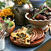 Platter with Grilled Sausage and Peppers with Thyme, Barbecued Chicken with Rosemary and Salad