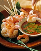 Shrimps on sticks with tomato and basil dip