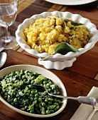Two side dishes: pumpkin with sage, peas