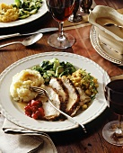 Sliced roast pork with vegetables and cranberry relish