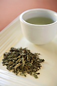 Loose Mint Tea Leaves with Cup of Mint Tea