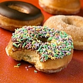 Glazed Donut with Sprinkles with Bite Taken Out of It, Assorted Donuts