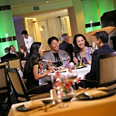 Two Couples Dining in Restaurant