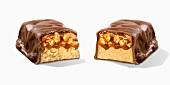 A nut and caramel bar, cut in half