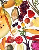 An arrangement of fruit and vegetables on a glass platter