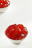 Two Bowls of Candied Red Cherries on White