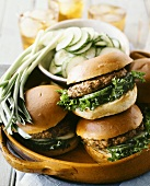 Vegetable burgers with spring onions and cucumber slices