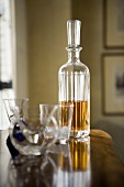 Scotch in a Decanter with Empty Glass on a Table