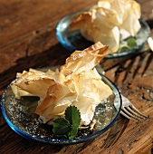 Sweet filo pastries with icing sugar