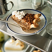 A piece of pecan pie with cream (USA)