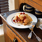 Ice cream on puff pastry fan with raspberries and almonds