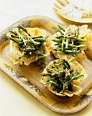 Phyllo Cups Stuffed with Roasted Asparagus on a Platter