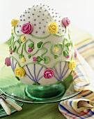 Easter Egg Cake on a Plate with Frosting Rose Decorations