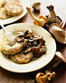 Polenta Cakes with Wild Mushrooms on a Plate with Fork; Mushrooms