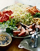 Salad Platter with Sliced Steak; Small Pitcher of Dressing