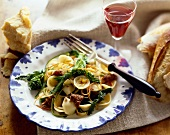 Orrecchietti Pasta with Sausage and Broccoli Rabe on a Plate with Fork; Glass of Wine