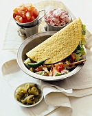 Roast Chicken Taco in a Bowl, Small Bowls of Toppings, Jalapeno Slices, Tomatoes and Red Onion