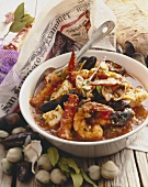 Bowl of Seafood Stew with Spoon, Shellfish with Newspaper