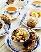 Servings of Fruit Salad with Chocolate Muffins; Cup of Tea