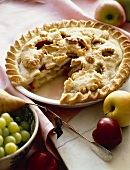 Fruit Pie with Apples, Plums and Grapes; Slice Removed